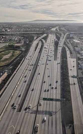 Interstate 405 (California) - Aerial view from the north of Interstate 405's interchange with Interstate 105 near Los Angeles International Airport.  The photo is from directly above Arbor Vitae Street. The hills of the Palos Verdes Peninsula are visible in the distance.