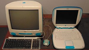IBook - An iBook G3 (right) and iMac G3 (left) in Blueberry color. The original iBook G3 sported a clamshell design in one of five colors that matched the iMac G3.