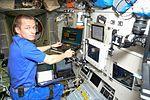 ISS-50 Sergey Ryzhikov works inside the Zvezda Service Module.jpg