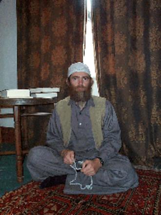 David Myatt - Abdul-Aziz ibn Myatt after his conversion to Islam in 1998, wearing a Thawb and a Taqiyah (cap) (aka Kufi)