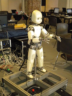 ICub - An iCub robot mounted on a supporting frame. The robot is 104 cm high and weighs around 22 kg