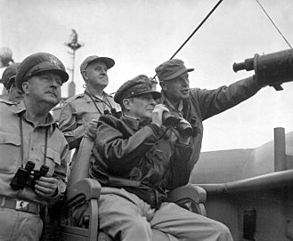 USS Mount McKinley - MacArthur observes the naval shelling of Incheon from Mount McKinley, 15 September 1950 with Brigadier General Courtney Whitney (left) and Major General Edward M. Almond (right).