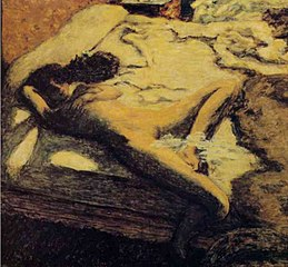 Sleeping woman on a bed