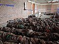Interior of Catholic Church Genocide Memorial Site with Piled Clothes of Victims - Nyamata - Rwanda.jpg