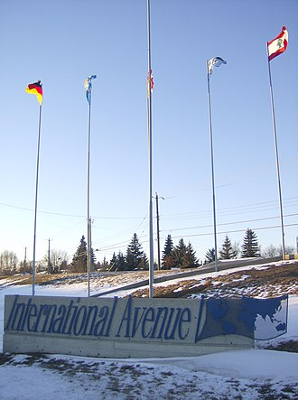 International Avenue, Calgary - A sign and set of international flags along International Avenue (17 Avenue SE).