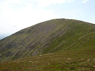 Knockmealdown - Knockmealdown east face and summit The screes are steep and barren looking though sheep are grazing
