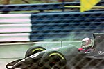 JJ Lehto - Sauber C12 heads for Copse during practice for the 1993 British Grand Prix (33686700885).jpg