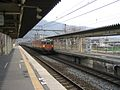 JNR 113 Shonan and JRW liveries approaching Umahori Station 2006-04-04.jpg