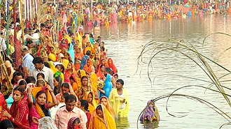 Chhath - Performing of prayer to Sun around the holy rivers, ponds  and other small water bodies