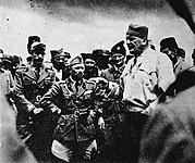 A tall male Chetnik amongst a group of men dressed in Italian Army uniform