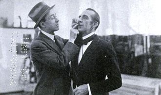 John Emerson (filmmaker) - John Emerson gluing a moustache on Frank Stockdale in 1921
