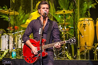 John Stamos - Stamos playing with The Beach Boys at Neal S. Blaisdell Center in Honolulu, Hawaii, January 2014