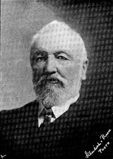 portrait photo of John Thomas Peacock, showing a grey-haired older man with full beard in formal clothes