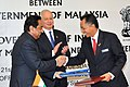 Kamal Nath signing the MoU in the field of highway management and development in India with the Minister of Works, Government of Malaysia, Dato' Shaziman bin Abu Mansor.jpg