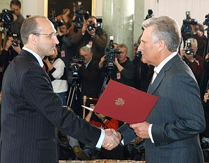 Prime Minister of Poland - Prime Minister Kazimierz Marcinkiewicz (left) being sworn in by President Aleksander Kwaśniewski (right) in October 2005.