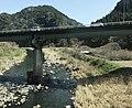 Kusugawa River and Ikenoharubashi Bridge from train of Kyudai Main Line.jpg