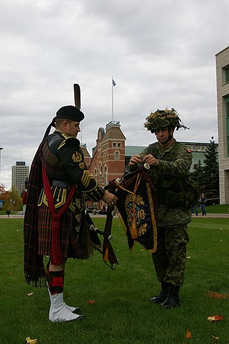 Pipe banner - LCol Bud Walsh Presents Pipe banner to Pipe-Major Alan Clark - 20 Oct 2007.JPG
