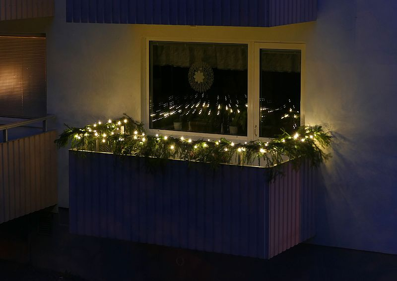 File:LED lights and spruce twigs decoration on a balcony.jpg