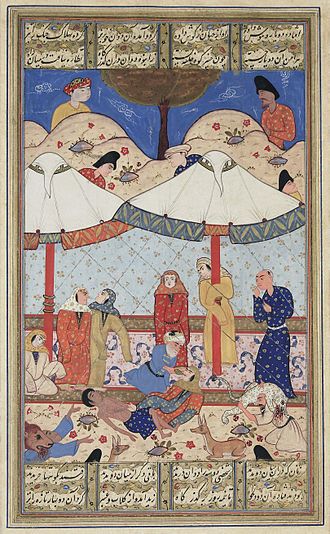 Layla and Majnun - A miniature of Nizami's work. Layla and Majnun meet for the last time before their deaths. Both have fainted and Majnun's elderly messenger attempts to revive Layla while wild animals protect the pair from unwelcome intruders.  Late 16th-century illustration.