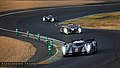 Le Mans 2011 - Race - Audi R18 -2 and Peugeot 908 -8 and -7.jpg