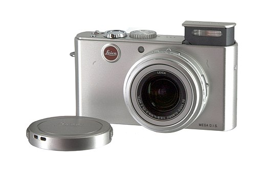 Compact Digital Camera - Leica D-Lux-2 with lens cover and white background by Rama