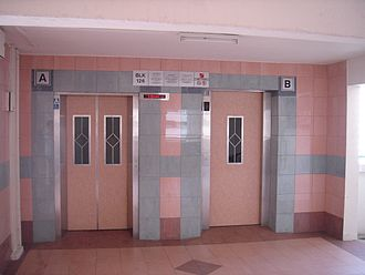 Lift Upgrading Programme - Upgraded elevators in a HDB block. Lift A (left), built under LUP specifications stops at all floors, while Lift B (right) is usually seen in older IUP/MUP as an aesthetic update that continues to stop at selective floors.