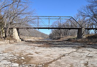 Little Walnut River Pratt Truss Bridge - Side view of the Little Walnut River Pratt Truss Bridge