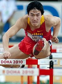 Liu Xiang jumping through hurdle during his 110 meters hurdles race