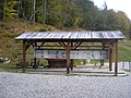Log pod Mangartom-eaved platform.jpg