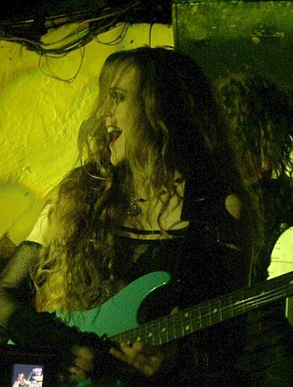 Lori Linstruth - Lori Linstruth performing guitar with Stream of Passion in 2006.