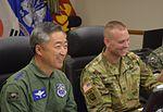 Lt. Gen. Wang Keun Lee, left, commander, Republic of Korea Air Force Operations, and Col. Mark Holler, commander, 35th Air Defense Artillery Brigade, share a brief laugh.jpg
