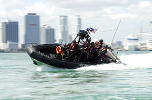 Maritime Safety and Security Team - A boatcrew from Coast Guard Maritime Safety and Security Team 91114 conducts high-speed maneuvers during a security patrol south of the Port of Miami.