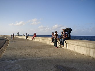 Seawall - People socializing and walking at the Malecón, Havana