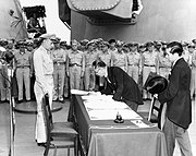 Japanese foreign affairs minister Mamoru Shigemitsu signs the Instrument of Surrender.