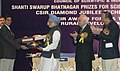 Manmohan Singh giving away the Shanti Swarup Bhatnagar Prize for Science and Technology 2008 to Dr. P.N. Vinayachandran of Bangalore for his outstanding contribution in Earth, Atmosphere, Ocean and Planetary Sciences.jpg