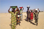 Women in Mao, where water is provided by a water tower. Access to clean water is often a problem in Chad.