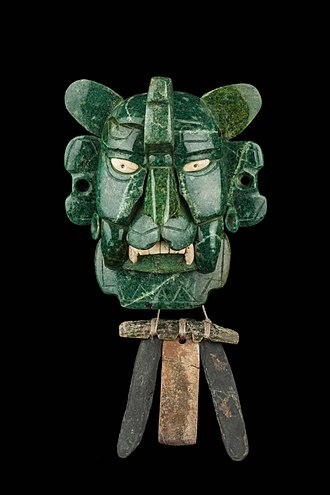 Zapotec civilization - Zapotec mosaic mask that represents a Bat god, made of 25 pieces of jade, with yellow eyes made of shell. It was found in a tomb at Monte Alban