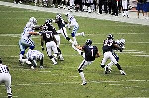 Matt Turk - Turk Punting a football