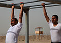 Members of Iraqi Police and Border Patrol negotiate the monkey bars while running an obstacle course at the Police Academy in Basrah, Iraq, May 4, 2011 110504-A-YD132-196.jpg