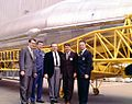 Mercury astronauts--'Mercury binder; Wally Schirra and 4 men posing in front oif Atlas (15909763337).jpg