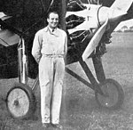 Michel Detroyat standing Morane-Saulnier MS.130 L'Air July 15,1929.jpg