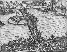Horsemen fight against each other on a bridge and along a river while ships deliver soldiers on the river
