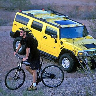 Montague Bikes - Montague Hummer Bike next to Hummer H2.