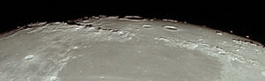 Montes Caucasus - View of the limb of the moon showing Montes Apenninus (left), Montes Caucasus (right), eastern Mare Imbrium (top), and western Mare Serenitatis (bottom), from Apollo 11