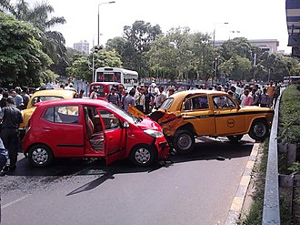 Traffic accidents in India - Multiple vehicle collision occurred on a busy road crossing at office time in Kolkata.