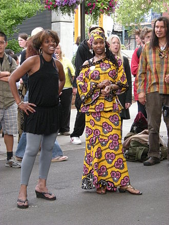 2000s in fashion - Young woman wearing dress made from African patterned fabric.