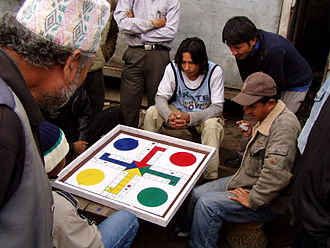Ludo (board game) - Pachisi variant being played on a Ludo board in Nepal