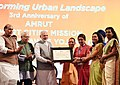 "Narendra Modi presenting awards during the event ""Transforming Urban Landscape Third Anniversary of Pradhan Mantri Awas Yojana (Urban).JPG"