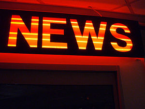 "Neon sign displaying ""News"""