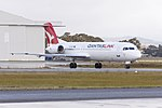 """Network Aviation (VH-NHP) Fokker 100, in new Qantaslink """"new roo"""" livery, taxiing at Wagga Wagga Airport.jpg"""